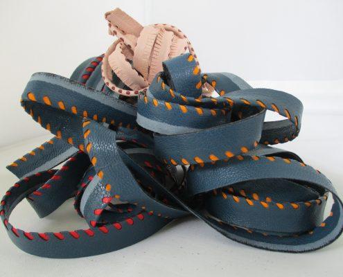 Profili forati per abbigliamento e calzature
